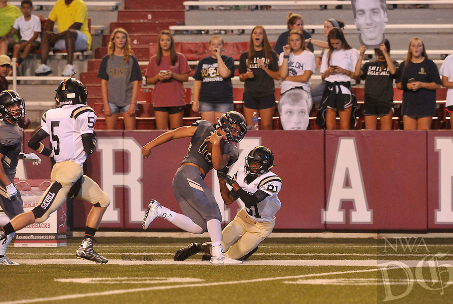 NWA Democrat-Gazette/MICHAEL WOODS &bull; @NWAMICHAELW<br /> Shiloh Christian receiver Broc Berus is tackled by Charleston defender Sean Flanagan Tuesday September 1, 2015 at Razorback Stadium in Fayetteville.