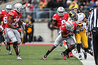 Iowa Hawkeyes running back Damon Bullock (5) is knocked out of bounds by Ohio State Buckeyes cornerback Bradley Roby (1) during Saturday's game in Columbus, Ohio on Saturday, Oct. 19, 2013. (Jabin Botsford / The Columbus Dispatch)