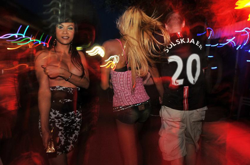 Thai transgender prostitutes greet Sailors in Pattaya.