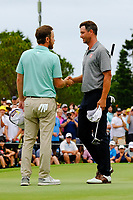 Nick Flanagan (AUS) congratulates Adam Scott (AUS) as he wins on the 18th green during round 4 of the Australian PGA Championship at  RACV Royal Pines Resort, Gold Coast, Queensland, Australia. 22/12/2019.<br /> Picture TJ Caffrey / Golffile.ie<br /> <br /> All photo usage must carry mandatory copyright credit (© Golffile   TJ Caffrey)
