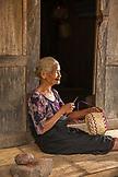 INDONESIA, Flores, portraits of an elder woman basket maker at Belaraghi village