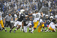 21 September 2013:  Penn State DE Deion Barnes (18) chases Kent State QB Colin Reardon (10) . The Penn State Nittany Lions defeated the Kent State Golden Flashes 34-0 at Beaver Stadium in State College, PA. .