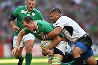 Devin Toner of Ireland is tackled by Paulica Ion of Romania. Rugby World Cup Pool D match between Ireland and Romania on September 27, 2015 at Wembley Stadium in London, England. Photo by: Patrick Khachfe / Onside Images