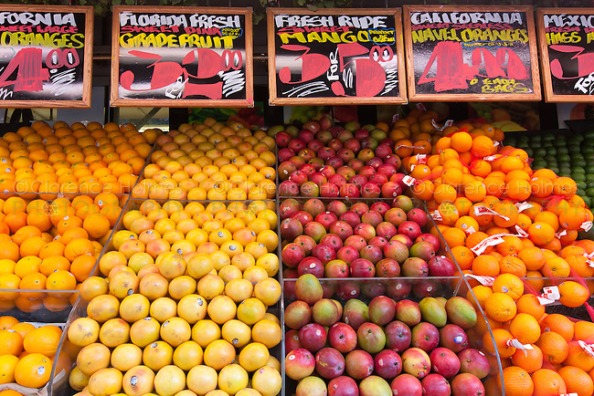 Fresh fruits and vegetables on-sale at a grocery market street display in New York City.