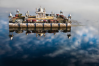In the early morning light this lovely lake temple seems to be floating in the clouds. (Photo by Matt Considine - Images of Asia Collection)