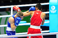 Australia's Nick Cooney (blue) defeats Malaysia's Muhammad Alnaz Othman (red) in the men's light (62kg) round of 32. The fight was stopped in the first round and went to judges score cards due to a cut on the face of Muhammad Alnaz Othman caused by an accidental clash of heads.<br /> <br /> Photographer Chris Vaughan/CameraSport<br /> <br /> 20th Commonwealth Games - Day 3 - Saturday 26th July 2014 - Boxing - SECC - Glasgow - UK<br /> <br /> © CameraSport - 43 Linden Ave. Countesthorpe. Leicester. England. LE8 5PG - Tel: +44 (0) 116 277 4147 - admin@camerasport.com - www.camerasport.com