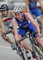 30 JUN 2007 - COPENHAGEN, DEN - Britains Alistair Brownlee (GBR) takes a corner  ahead of Joao Silva of Portugal during the European Triathlon Championships. (PHOTO (C) NIGEL FARROW)