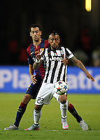 Calcio, finale di Champions League Juventus vs Barcellona all'Olympiastadion di Berlino, 6 giugno 2015.<br /> Juventus' Arturo Vidal, right, is challenged by FC Barcelona's Sergio Busquets during the Champions League football final between Juventus Turin and FC Barcelona, at Berlin's Olympiastadion, 6 June 2015. Barcelona won 3-1.<br /> UPDATE IMAGES PRESS/Isabella Bonotto