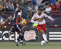 New York Red Bulls forward Andre Akpan (15) on the attack. In a Major League Soccer (MLS) match, the New England Revolution (blue) tied New York Red Bulls (white), 1-1, at Gillette Stadium on May 11, 2013.