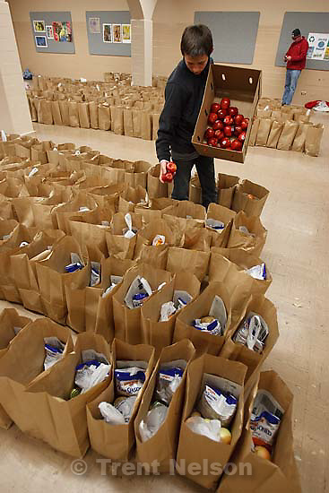 Rowland Hall-St. Marks and Crossroads Urban Center hosted the annual Christmas Dinner Give-Away on Wednesday, December 23, 2009. This annual event makes Christmas a happier time of year for economically disadvantaged families and individuals. This year, the volunteers expect to distribute food to 1400 families. Wednesday, December 23, 2009.