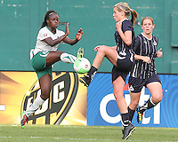 Allie Long #9 of the Washington Freedom and Eniola Aluko #9 of St. Louis Athletica go for a loose ball during a WPS match on May 1 2010, at RFK Stadium, in Washington D.C. Freedom won 3-1.