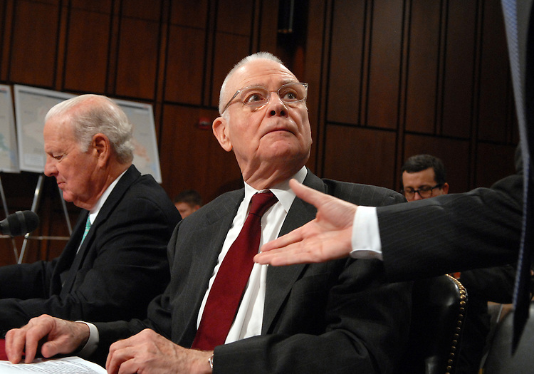 Lee Hamilton, co-chairman of the Iraq study Group, notices the introduction of Sen. John Sununu, R-N.H., before a continuing hearing on alternative plans for Iraq.  James Baker, co-chairman of the Iraq study Group, appears at left.