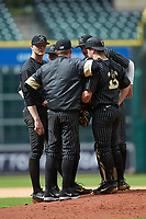 Vanderbilt Commodores pitching coach Derek Johnson (second from left) meets on the mound with starting pitcher Drake Fellows (left) and catcher Stephen Scott (19) during the game against the Sam Houston State Bearkats in game one of the 2018 Shriners Hospitals for Children College Classic at Minute Maid Park on March 2, 2018 in Houston, Texas. The Bearkats walked-off the Commodores 7-6 in 10 innings.   (Brian Westerholt/Four Seam Images)
