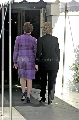 Washington, DC - December 18, 2000 -- First Lady Hillary Rodham Clinton welcomes incoming First Lady Laura Bush to the White House in Washington, D.C. on December 18, 2000.<br /> Credit: Ron Sachs / CNP/MediaPunch