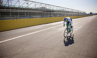Michael Matthews (AUS/Orica-GreenEDGE) testing his legs on the finish straight of the Monza F1 Race Circuit and hitting 88km/h (coming from behind the team car)<br /> <br /> training/coffee ride with Team Orica-GreenEDGE at Monza (race circuit park) 1 day before the Milan-San Remo