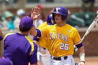 LSU Tigers catcher Ty Ross (26) is greeted by the dugout after he scored against the Texas A&M Aggies in the NCAA Southeastern Conference baseball game on May 11, 2013 at Blue Bell Park in College Station, Texas. LSU defeated Texas A&M 2-1 in extra innings to capture the SEC West Championship. (Andrew Woolley/Four Seam Images).