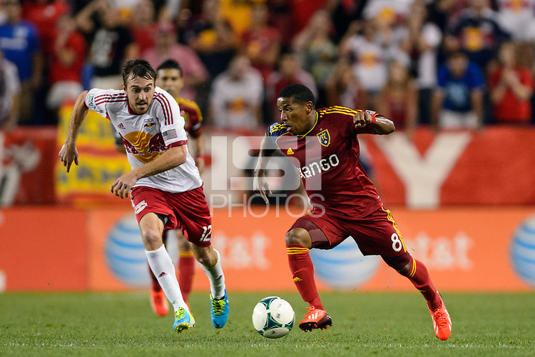 Joao Plata (8) of Real Salt Lake and Eric Alexander (12) of the New York Red Bulls. The New York Red Bulls defeated Real Salt Lake 4-3 during a Major League Soccer (MLS) match at Red Bull Arena in Harrison, NJ, on July 27, 2013.