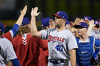 Buffalo Bisons relief pitcher Jason Adam (40) high fives teammates after closing out the win over the Charlotte Knights at BB&T BallPark on July 24, 2019 in Charlotte, North Carolina. The Bisons defeated the Knights 8-4. (Brian Westerholt/Four Seam Images)