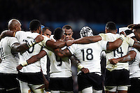 The Fiji team huddle together during a break in play. Rugby World Cup Pool A match between England and Fiji on September 18, 2015 at Twickenham Stadium in London, England. Photo by: Patrick Khachfe / Onside Images