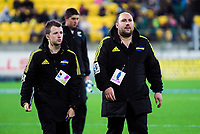 Hurricanes event staff Johnny Schmitt and Michael Langley during the Super Rugby match between the Hurricanes and Reds at Westpac Stadium in Wellington, New Zealand on Friday, 18 May 2018. Photo: Dave Lintott / lintottphoto.co.nz