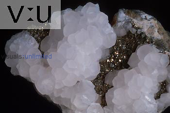 White calcite (CaCo3 positive pyritohedron form normally attributed to pyrite. In situ with pyrite matrix