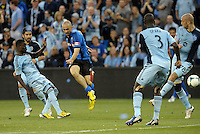 Marco Di Vaio (9) forward Montreal Impact has  a shot on goal.<br /> Montreal Impact defeated Sporting Kansas City 2-1 at Sporting Park, Kansas City, Kansas.