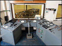 BNPS.co.uk (01202 558833)<br /> Pic: PhilYeomans/BNPS<br /> <br /> The control room.<br /> <br /> Sci-fi 'Centrifuge' to open its doors to the public after 64 years...<br /> <br /> A remarkable Cold War relic which has put thousands of pilots through their G-force paces has made its final spin after six decades. <br /> <br /> The Top Secret building at the former RAE Farnborough test site is now open to the public for guided tours led by the scientists from FAST who used to work there.<br /> <br /> The Farnborough Centrifuge was used to simulate huge 9G forces - nine times more than a human body is designed to absorb - they would encounter while flying fast jets during combat operations.<br /> <br /> The pilot would sit in a small compartment replicating a cockpit at the end of the 60ft rotating arm and be propelled at over 60mph, spinning 30 times a minute.<br /> <br /> A staggering 122,133 tests were performed on it before it was decommissioned in March this year, with a new centrifuge installed at RAF Cranwell.<br /> <br /> It featured on an episode of Top Gear in 2000 when Jeremy Clarkson had a go on it at 3G, leaving him in obvious discomfort. He described the force exerted on him as like 'having an elephant sat on my chest'.<br /> <br /> The centrifuge, which is being displayed for the public for the first time, also appeared in the 1985 comedy film Spies Like Us starring Chevy Chase and Dan Ackroyd.