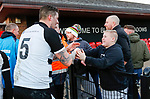 A Darlington fan shakes hands with Liam Hughes as he leaves the pitch. Darlington 1883 v Southport, National League North, 16th February 2019. The reborn Darlington 1883 share a ground with the town's Rugby Union club. <br />