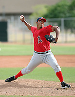 Baudilio Lopez #13 of the Los Angeles Angels plays in a minor league spring training game against the Chicago Cubs at the Angels minor league complex on April 3, 2011  in Tempe, Arizona. .Photo by:  Bill Mitchell/Four Seam Images.