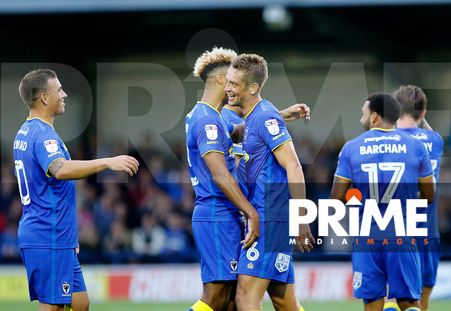 GOAL - AFC Wimbledon's Paul Robinson is greeted after his goal during the Carabao Cup match between AFC Wimbledon and Brentford at the Cherry Red Records Stadium, Kingston, England on 8 August 2017. Photo by Carlton Myrie.