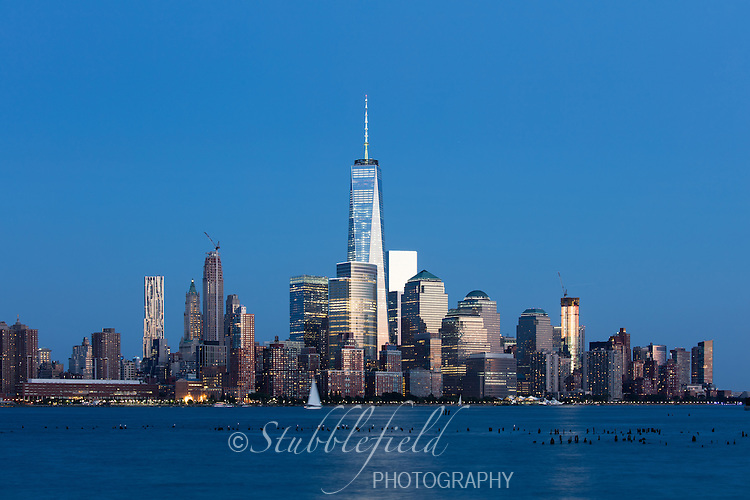 View of lower Manhattan and the Freedom Tower at sunset from Newport in Jersey City, New Jersey.