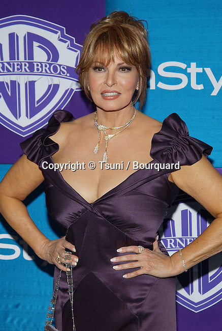 Raquel Welch arriving at the Warner In Style Party affter the Golden Globes at the Beverly Hilton in Los Angeles. january 16, 2005.