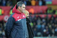 (L-R) Swansea manager Paul Clement and Manchester City manager Pep Guardiola watch the game from the touch line during the Premier League match between Swansea City and Manchester City at The Liberty Stadium, Swansea, Wales, UK. Wednesday 13 December 2017