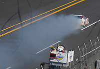 Apr 29, 2007; Talladega, AL, USA; Nascar Nextel Cup Series officials look on as David Reutimann (00) blows his engine during the Aarons 499 at Talladega Superspeedway. Mandatory Credit: Mark J. Rebilas