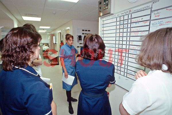 Doctors and nurses in an A&E department at the change over of a shift going through the process of handing over patients notes and discussing their medication and treatments. This image may only be used to portray the subject in a positive manner..©shoutpictures.com..john@shoutpictures.com