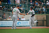 Clinton LumberKings manager Mike Jacobs (17) congratulates Evan Edwards (18) after hitting a home run during a Midwest League game against the Great Lakes Loons on July 19, 2019 at Dow Diamond in Midland, Michigan.  Clinton defeated Great Lakes 3-2.  (Mike Janes/Four Seam Images)