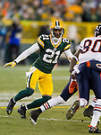 Green Bay Packers defensive back Charles Woodson (21) plays defense during a week 16 NFL football game against the Chicago Bears on December 25, 2011 in Green Bay, Wisconsin. The Packers won 35-21. (AP Photo/David Stluka)
