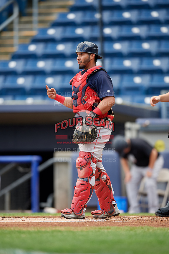 Lowell Spinners catcher Alberto Schmidt (20) signals to the defense during a game against the Staten Island Yankees on August 22, 2018 at Richmond County Bank Ballpark in Staten Island, New York.  Staten Island defeated Lowell 10-4.  (Mike Janes/Four Seam Images)