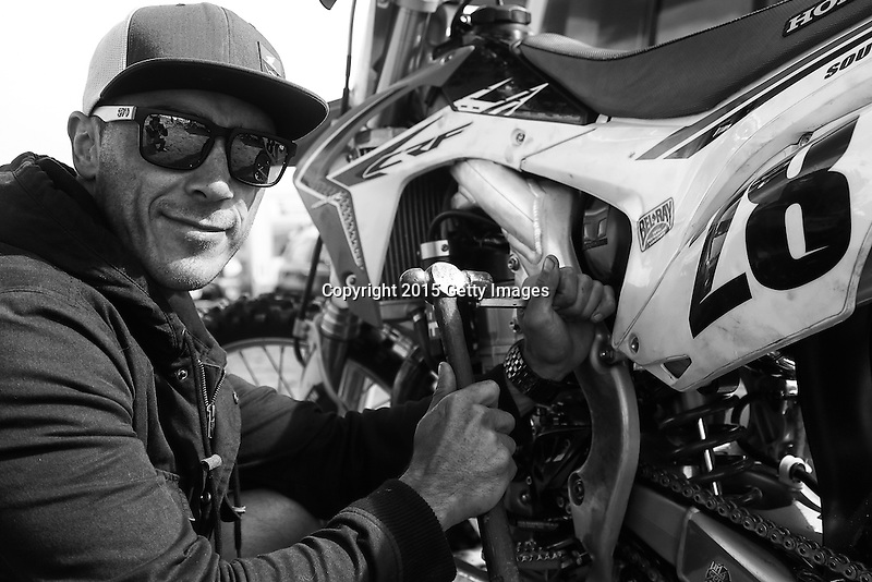 INVERCARGILL, NEW ZEALAND - NOVEMBER 27:  Haydon South of Timaru makes repairs to his motorcycle before his race in the Indian Motorcycle NZ Beach Racing Champs during the 2015 Burt Munro Challenge on November 27, 2015 in Invercargill, New Zealand.  (Photo by Dianne Manson/Getty Images) *** Local Caption *** Hayden South