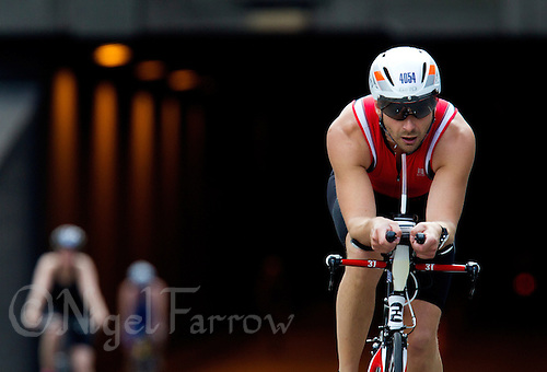 12 JUL 2014 - HAMBURG, GER - René Blenn prepares to enter transition at the end of his bike leg during the age group Sprint Distance race during the 2014 ITU World Triathlon Series event in Hamburg in Germany (PHOTO COPYRIGHT © 2014 NIGEL FARROW, ALL RIGHTS RESERVED)