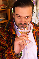 Gustavo Pisano one of the brothers Pisano tasting a glass of wine. Bodega Pisano Winery, Progreso, Uruguay, South America
