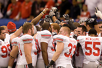 Ohio State players huddle together before going back in the tunnel during 77th Annual Allstate Sugar Bowl Classic at Louisiana Superdome in New Orleans, Louisiana on January 4th, 2011.  Ohio State defeated Arkansas, 31-26.