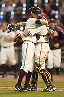 Arizona State freshman Mike Leake (8) gets a hug from catcher Petey Paramore (13) after Leake pitched 5 innings of one hit, no run relief versus Texas A&M at the 2007 Houston College Classic at Minute Maid Park in Houston, TX, Friday, February 9, 2007.  Arizona State defeated Texas A&M 5-4.