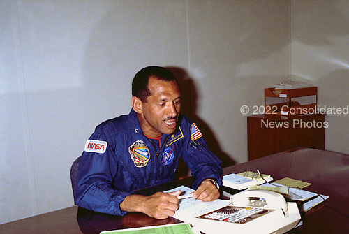 Cape Canaveral, FL - (FILE) -- At 1:30 a.m. EST the morning of April 28, 1989, the scheduled launch of Space Shuttle Mission STS-30 aboard Atlantis, astronaut Charles Bolden receives a call from the Vice President of the United States Dan Quayle. The Vice President called from the NASA tracking station in Australia while visiting the facility. STS-30 will launch the Magellan/Venus radar mapper spacecraft on a 15-month journey to Venus. This is the first U.S. planetary mission in 11 years and the first on Shuttle..Credit: NASA via CNP