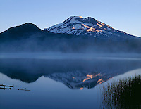 ORCAC_049 - USA, Oregon, Deschutes National Forest, Sunrise light on South Sister reflects in the misty waters of Sparks Lake.