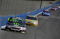 Feb 21, 2009; Fontana, CA, USA; NASCAR Camping World Truck Series driver Ricky Carmichael races into turn three during the San Bernardino County 200 at Auto Club Speedway. Mandatory Credit: Mark J. Rebilas-