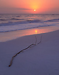 Sanibel Island, FL  ©Terry Donnelly  <br /> Pastel sunset colors off Bowman's Beach overlooking  the Gulf of Mexico with driftwood in the sand