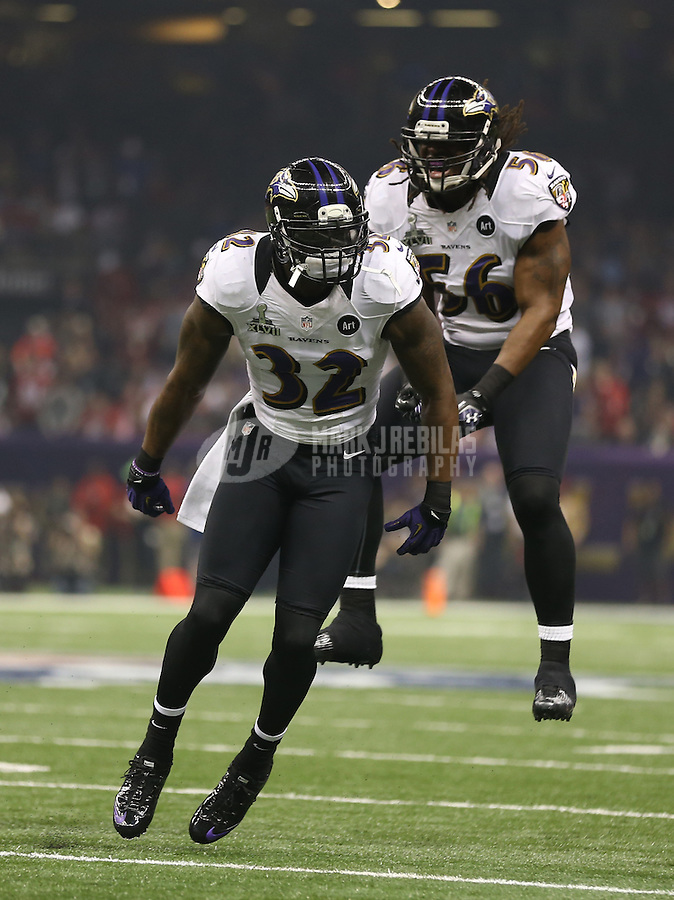 Feb 3, 2013; New Orleans, LA, USA; Baltimore Ravens safety James Ihedigbo (32) and linebacker Josh Bynes (56) celebrate a play against the San Francisco 49ers in Super Bowl XLVII at the Mercedes-Benz Superdome. Mandatory Credit: Mark J. Rebilas-