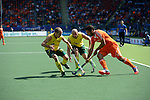 The Hague, Netherlands, June 15: Matthew Swann #20 of Australia and Glenn Turner #4 of Australia defend against Valentin Verga #10 of The Netherlands during the field hockey gold match (Men) between Australia and The Netherlands on June 15, 2014 during the World Cup 2014 at Kyocera Stadium in The Hague, Netherlands. Final score 6-1 (2-1)  (Photo by Dirk Markgraf / www.265-images.com) *** Local caption ***