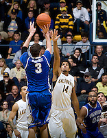 Christian Behrens of California tries to block Doug McDermott of Creighton during the game at Haas Pavilion in Berkeley, California on December 15th, 2012.   Creighton defeated California, 74-64.